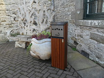 Free standing stylish cigarette ash bin available in hardwood or recycled plastic or rugged sleeper style ideal for outside club houses, hotels, and bars. approx 1mtr in height and can be bolted to the ground if necessary (designed by John Hunter)